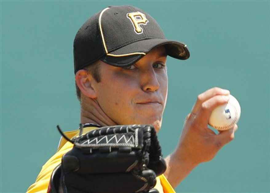 Pittsburgh Pirates pitcher Paul Maholm warms up before a spring training baseball game against the Tampa Bay Rays in Bradenton, Fla., Sunday, March 27, 2011. (AP Photo/Gene J. Puskar)