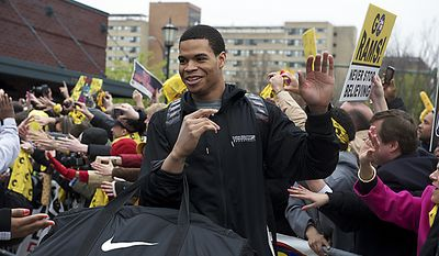 Virginia Commonwealth University Rams forward David Hinton makes his way to the team bus as the VCU men's basketball team departs the campus in Richmond on Wednesday, March 30, 2011, en route to its first appearance in the NCAA Final Four, which will take place in Houston. (Rod Lamkey Jr./The Washington Times)