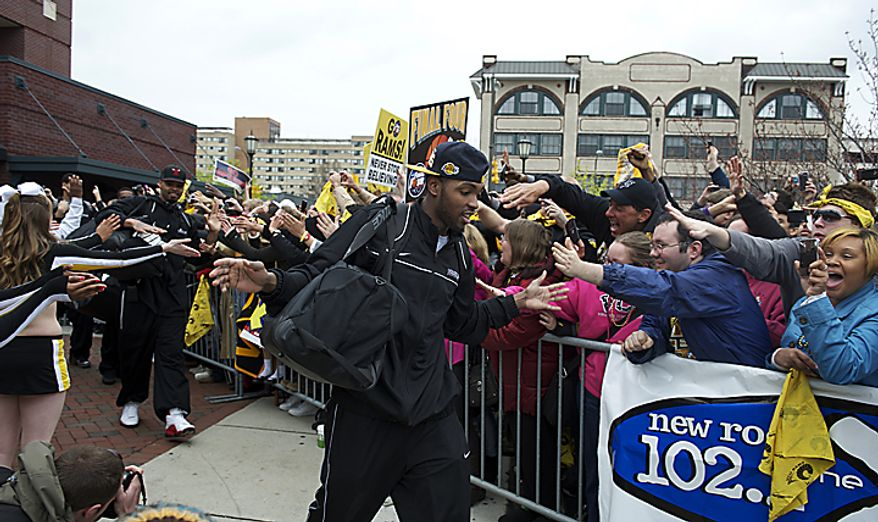 Virginia Commonwealth University Rams guard Ed Nixon makes his way to the team bus as the VCU men's basketball team departs the campus in Richmond on Wednesday, March 30, 2011, en route to its first appearance in the NCAA Final Four. VCU plays Butler University on Saturday evening in Houston. (Rod Lamkey Jr./The Washington Times)