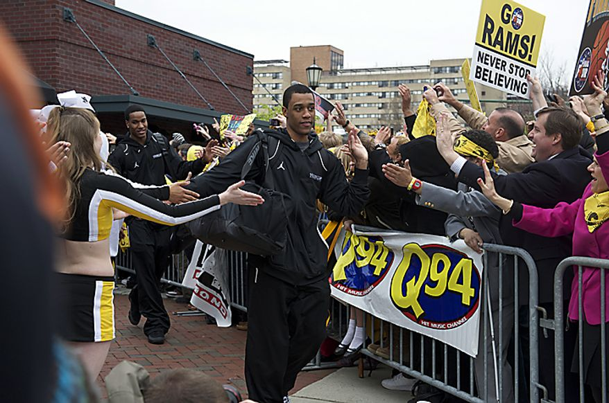Virginia Commonwealth University Rams guard Darius Theus makes his way to the team bus as the VCU men's basketball team departs the campus in Richmond on Wednesday, March 30, 2011, en route to Houston for the school's first appearance in the NCAA Final Four. (Rod Lamkey Jr./The Washington Times)