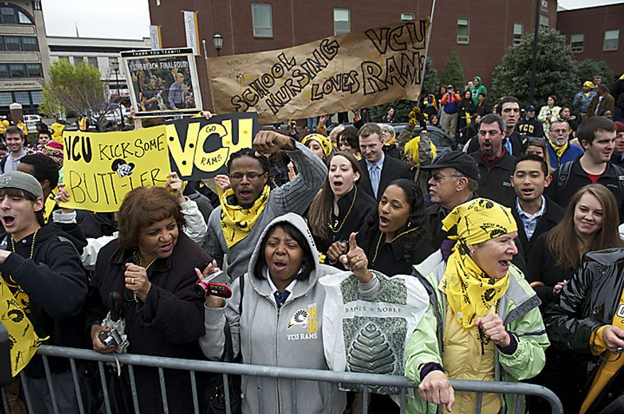 The crowd cheers while waiting for the Virginia Commonwealth University men's basketball team's departure from the campus in Richmond in Wednesday, March 30, 2011, en route to the university's first appearance in the NCAA Final Four, which begins Saturday in Houston. (Rod Lamkey Jr./The Washington Times)