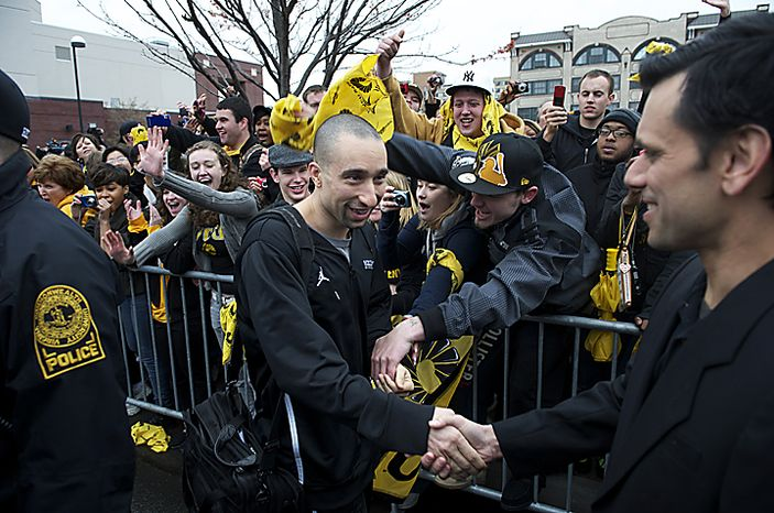 Virginia Commonwealth University Rams head coach Shaka Smart (left) is greeted by VCU President Michael Rao (right) as he makes his way to the team bus for the VCU men's basketball team's departure from the Richmond campus on Wednesday, March 30, 2011, en route to the school's first appearance in the NCAA Final Four. VCU plays Butler University on Saturday evening in Houston. (Rod Lamkey Jr./The Washington Times)