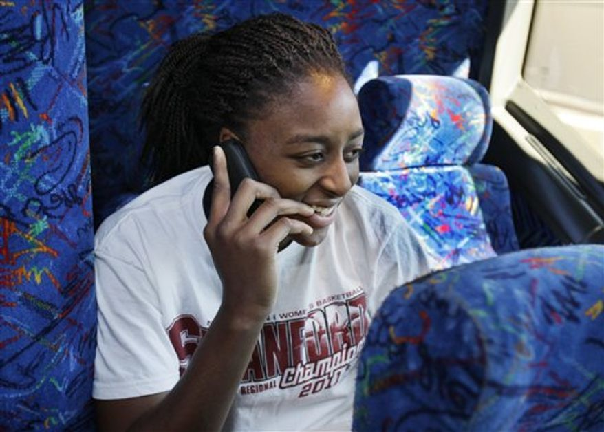 Stanford forward Nnemkadi Ogwumike chats on the phone as the team leaves from Stanford University in Stanford, Calif., Thursday, March 31, 2011, on their way to Indianapolis for the Final Four NCAA college basketball game. Stanford will play Texas A&M on Sunday. (AP Photo/Paul Sakuma)