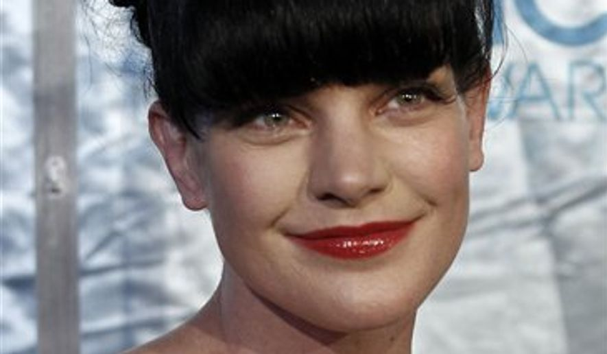 "Actress Pauley Perrette, from the CBS series,""NCIS,"" arrives at the People's Choice Awards in Los Angeles, in this Jan. 5, 2011, file photo. (AP Photo/Matt Sayles, file)"