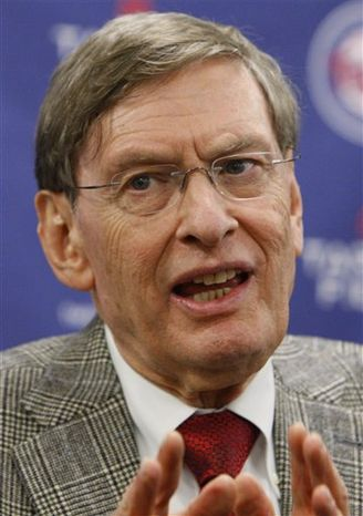 "FILE - This April 12, 2010, file photo shows baseball Commissioner Bud Selig during a news conference prior to the Minnesota Twins' home opener baseball game against the Boston Red Sox at their new stadium, Target Field, in Minneapolis.  Selig delivered the keynote address at the World Congress of Sports on Wednesday, telling attendees from the sports business world that he is ""very hopeful"" baseball's progress toward a labor agreement goes as smoothly as the last one came together in 2006. Baseball's current labor deal will expire in December. (AP Photo/Ann Heisenfelt, File)"