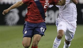 "FILE - In this March 29, 2011 file photo, United States defender Timothy Chandler (21) is chased by Paraguay midfielder Marceol Estigarribia (18) during the first half of an international friendly soccer match in Nashville, Tenn. Chandler, the son of an American serviceman and a German mother, says playing the U.S. national team is a ""dream come true."" (AP Photo/Mark Humphrey, File)"