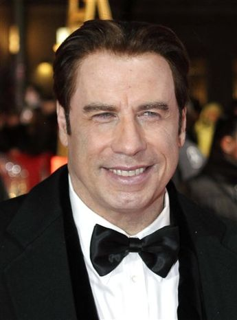 FILE - In this Feb. 5, 2011 file photo, U.S. actor John Travolta arrives for the 46th Golden Camera media award gala in Berlin, Germany. (AP Photo/Michael Sohn, file)