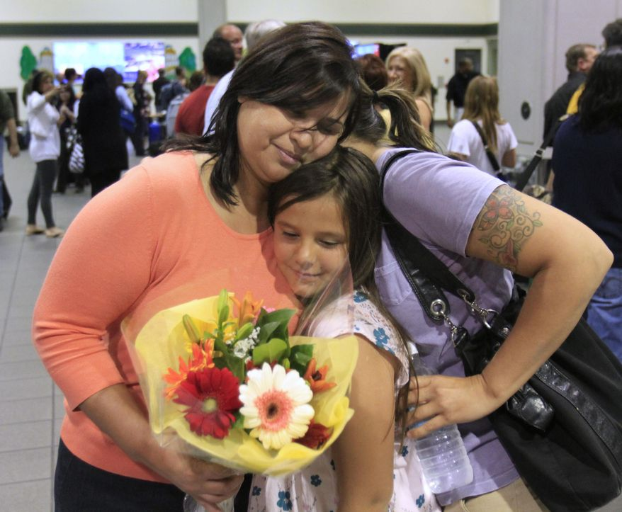 Southwest Airlines flight 812 passenger Mary Flores, left, is hugged by her granddaughter, Dylan Dean, 9, center and daughter Desiree, right, after arriving at Sacramento International Airport Friday, April 1, 2011. A fuselage rupture and a sudden drop in cabin pressure forced the flight from Phoenix to Sacramento to make an emergency landing at a Yuma military base Friday. (AP Photo/Rich Pedroncelli)