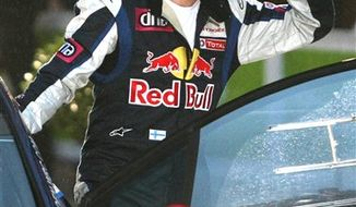 This photo taken Sept. 30, 2010  shows  Kimi Raikkonen of Finland  during the presentation of  Rally de France, in Strasbourg , eastern France, Thursday, Sept. 30, 2010.  Raikkonen is reportedly planning to enter a Truck Series race at Charlotte next month. If he does try NASCAR, he'd follow  Juan Pablo Montoya, Scott Speed and Nelson Piquet Jr. as the most recent former F1 drivers to move to America's most popular motorsports series. (AP Photo/Lionel Cironneau)