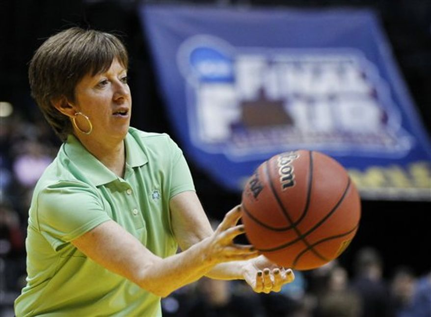 Notre Dame head coach Muffett McGraw listens as guard Skylar Diggins answers a question during a press conference before the women's NCAA Final Four national championship college basketball game in Indianapolis, Monday, April 4, 2011. Notre Dame faces Texas A&M in Tuesday's game. (AP Photo/Mark Duncan)