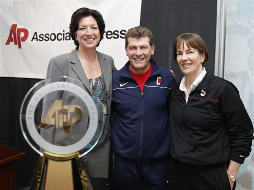 Miami's Katie Meier, left, Connecticut's Geno Auriemma, center, and Stanford's Tara VanDerveer pose after being selected as co-recipients of The Associated Press' coach of the year at the women's NCAA Final Four college basketball tournament in Indianapolis, Saturday, April 2, 2011. (AP Photo/Michael Conroy)
