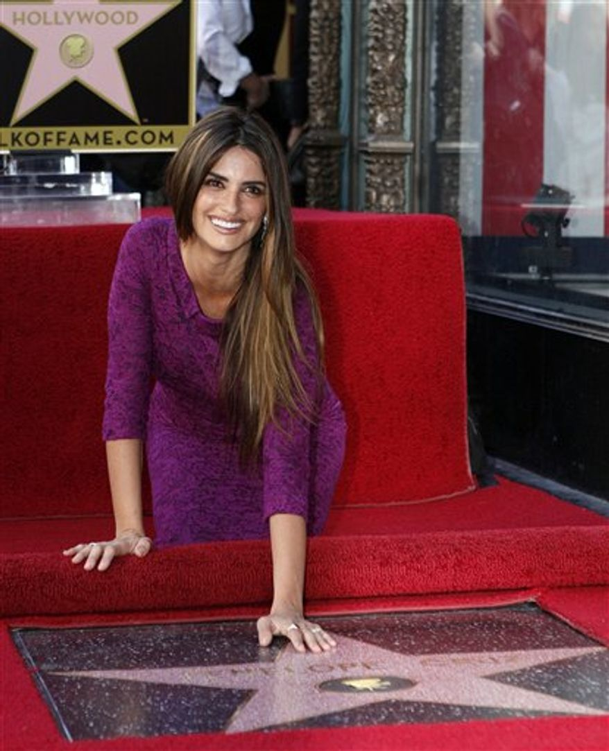 Spanish actress Penelope Cruz poses as she ishonored with a star on the Hollywood Walk of Fame on Friday, April 1, 2011 in Los Angeles. (AP Photo/Damian Dovarganes)