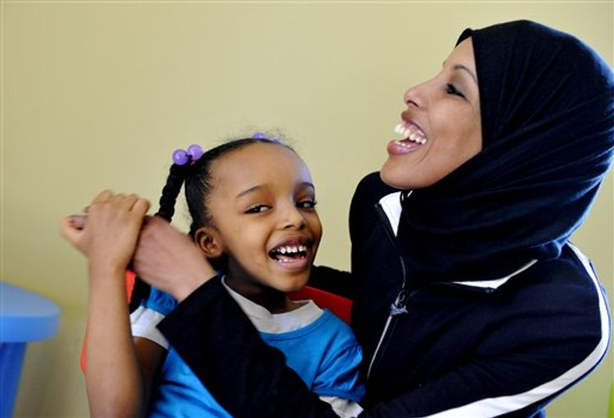 In this photo made March 29, 2011, Hodan Hassan is shown at her Minneapolis home with her six-year-old daughter Geni who has autism. Health officials struggling to contain a measles outbreak that's hit hard in Minneapolis' large Somali community are running into resistance from parents who fear the vaccine could give their children autism. (AP Photo/Jim Mone)