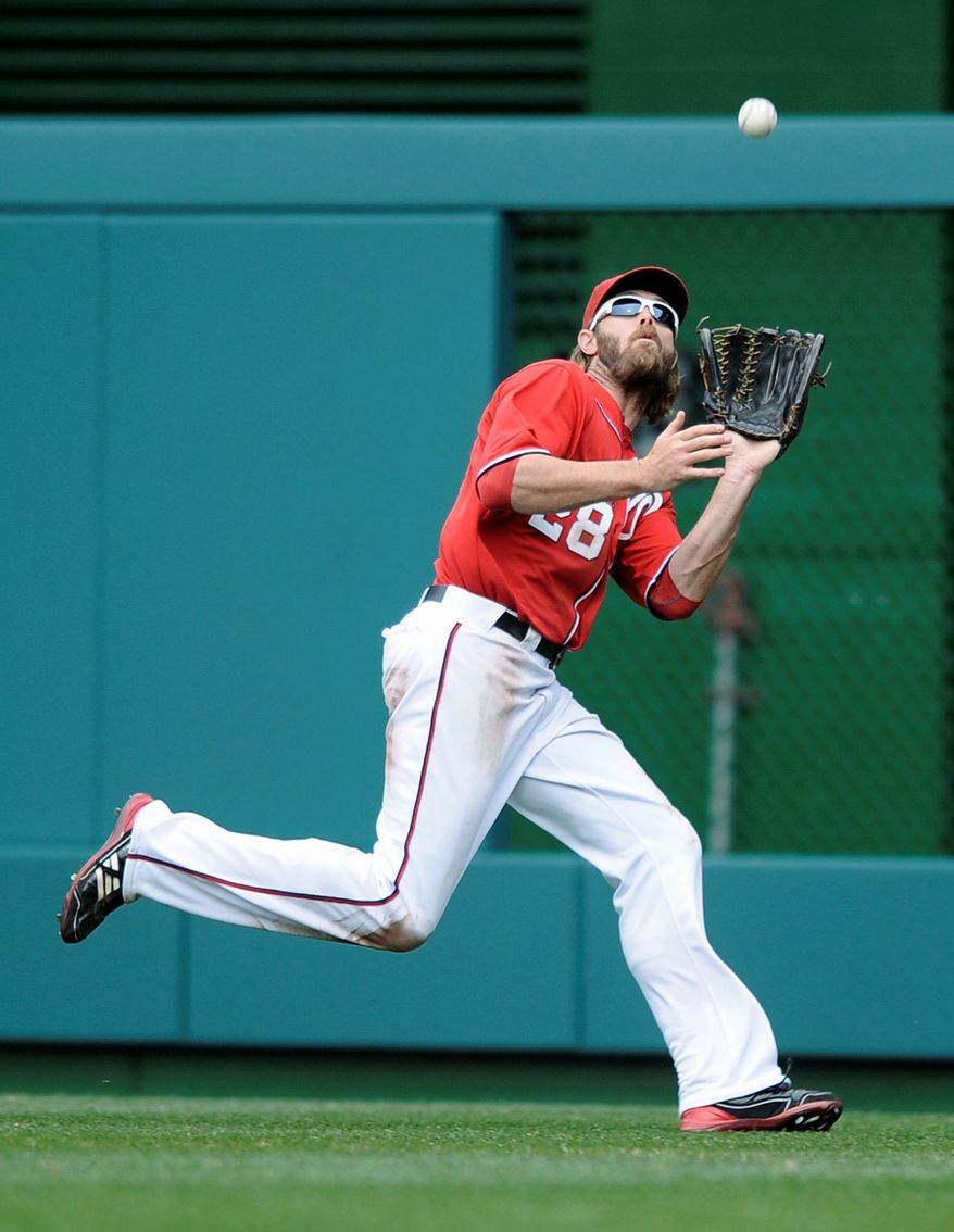 Nationals right fielder Jayson Werth catches a sacrifice fly off the bat of Atlanta's Martin Prado. Alex Gonzalez scored on the play as part of a six-run eighth inning for the Braves that saw Washington reliever Brian Broderick struggle in his major league debut. (Associated Press)