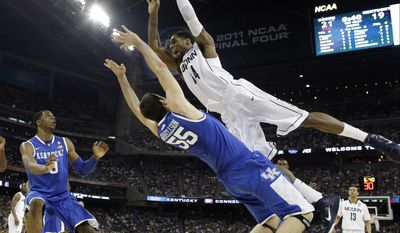 Connecticut's Alex Oriakhi loses the ball as Kentucky's Josh Harrellson defends during the first half of a men's NCAA Final Four semifinal college basketball game on Saturday, April 2, 2011, in Houston. (AP Photo/David J. Phillip)