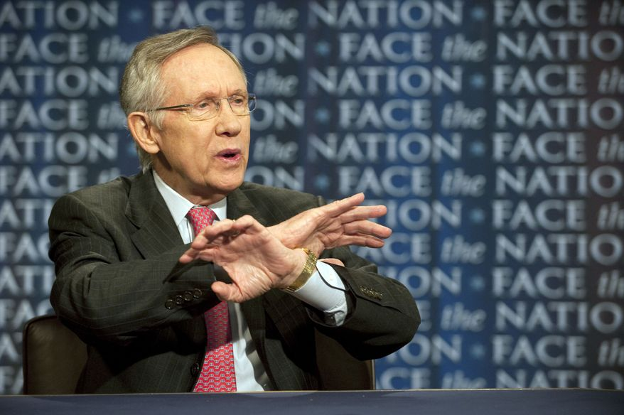 """Senate Majority Leader Harry Reid, Nevada Democrat, talks about the possibility of a government shutdown over a budget impasse and U.S. military action in Libya on CBS' """"Face the Nation"""" in Washington on Sunday, April 3, 2011. (AP Photo/CBS, Chris Usher)"""