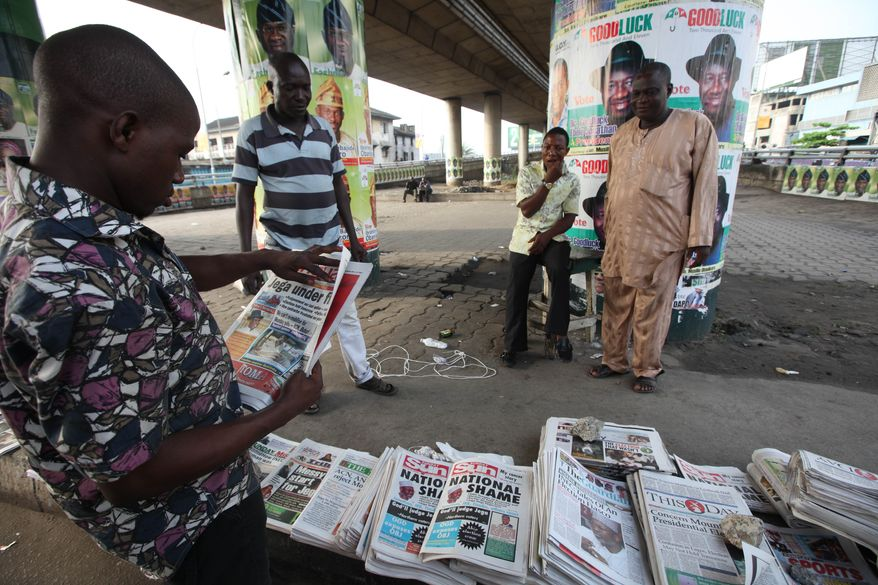 An unidentified man reads about the cancellation of National Assembly elections in Lagos, Nigeria, on Sunday, April 3, 2011. The head of the national election commission halted voting Saturday because ballot papers and tally sheets were missing from many areas. (AP Photo/Sunday Alamba)