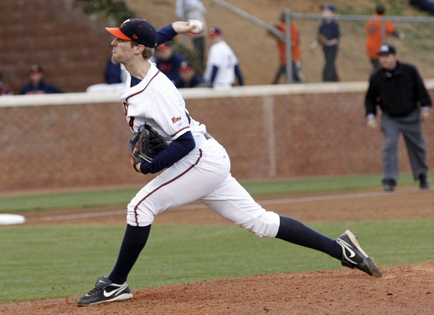 Virginia pitcher Will Roberts throws in a college baseball game against George Washington on Tuesday, March 29, 2011, in Charlottesville, Va, Roberts threw a perfect game. (AP Photo/The Daily Progress, Andrew Shurtleff)