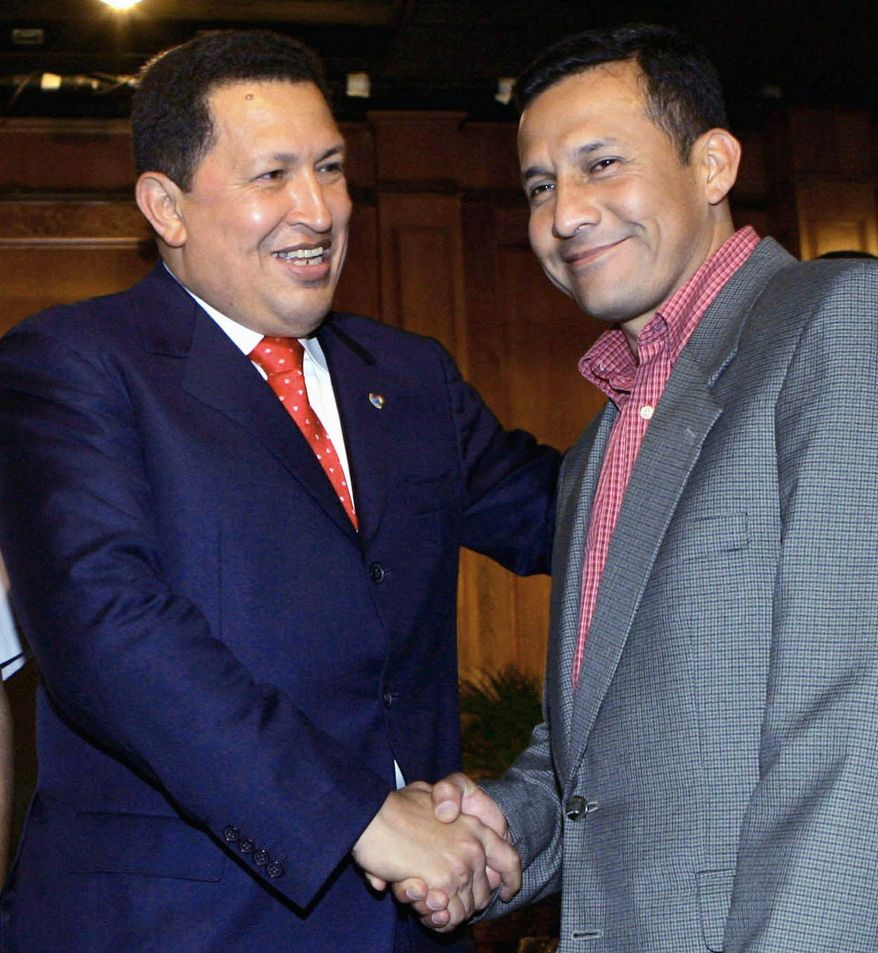 Analysts say Mr. Humala's close ties with Venezulean President Hugh Chavez (right) - himself the instigator of a failed coup in in 1992 - kept him from the presidency. Now Mr. Humala says he has changed, and he is at the top of a poll heading into Sunday's election. (Associated Press)
