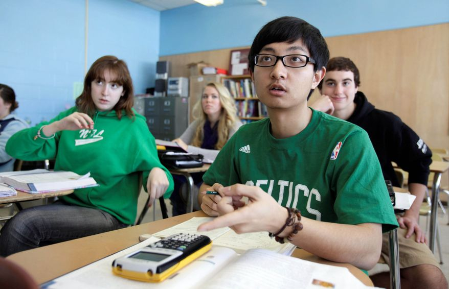 Chinese student Minzhe Zou answers a question in statistics class at Orono High School in Orono, Maine. (Associated Press)