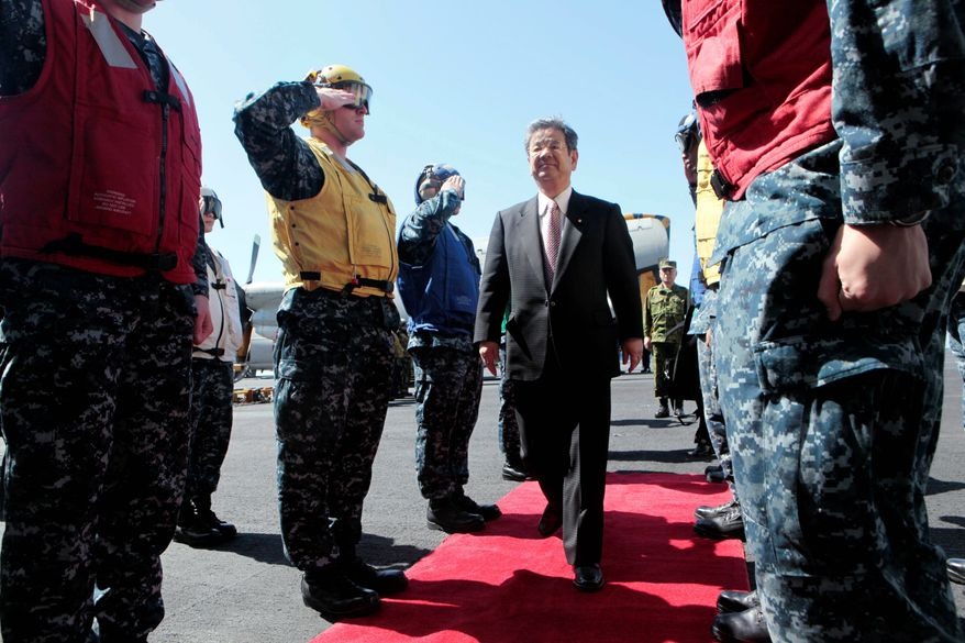 """Japan Defense Minister Toshimi Kitazawa, on board the USS Ronald Reagan on Monday, thanked the U.S. for its aid after the March 11 tsunami that ravaged Japan, telling the Reagan crew, """"The entire Japanese people are deeply moved."""" (Associated Press)"""