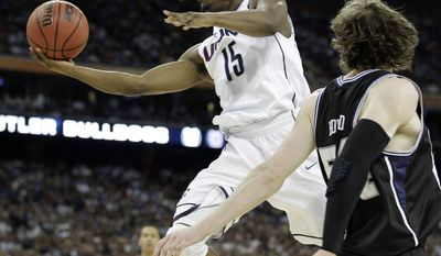 Connecticut's Kemba Walker shoots as Butler's Matt Howard defends during the second half of the men's NCAA Final Four college basketball championship game Monday, April 4, 2011, in Houston. (AP Photo/Eric Gay)