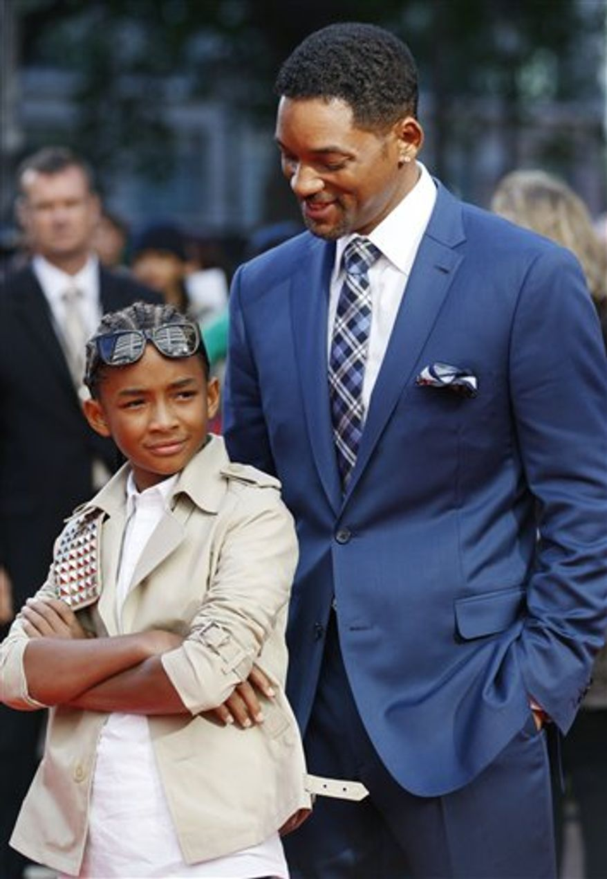 FILE  - In this July 15, 2010 file photo, actors Jaden Smith, left, and his father Will Smith arrive for the gala premiere of the film Karate Kid in London. (AP Photo/Sang Tan, file)