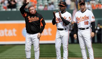 Orioles manager Buck Showalter (left) tips his hat to the crowd during Opening Day introductions at Camden Yards on Monday. Baltimore went on to beat the Detroit Tigers 5-1, improving to 4-0 with the win. (Associated Press)