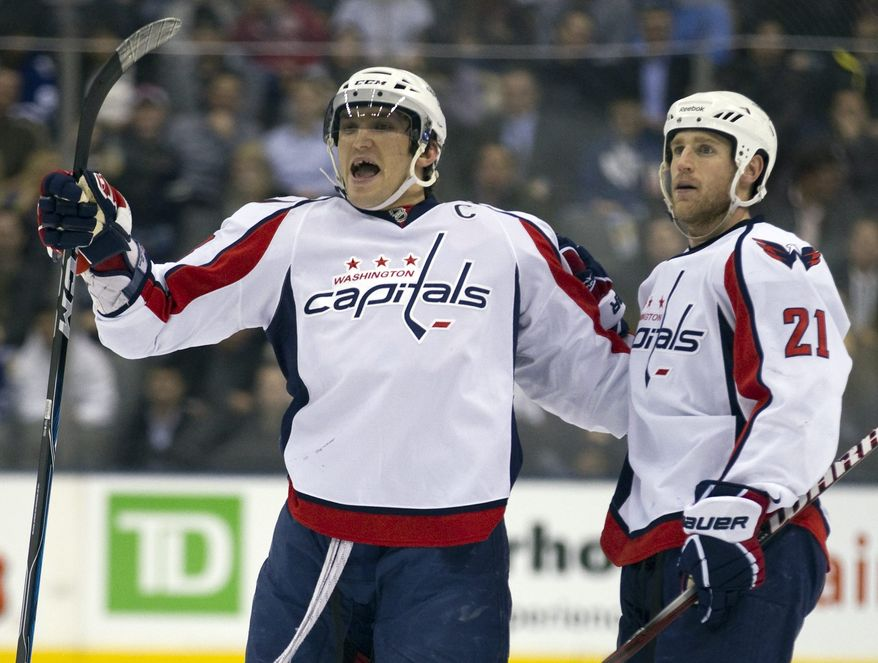 Washington Capitals Alexander Ovechkin, left, celebrates his goal with teammate Brooks Laich (21) during first period of an NHL hockey game in Toronto on Tuesday, April 5, 2011. (AP Photo/The Canadian Press, Frank Gunn)