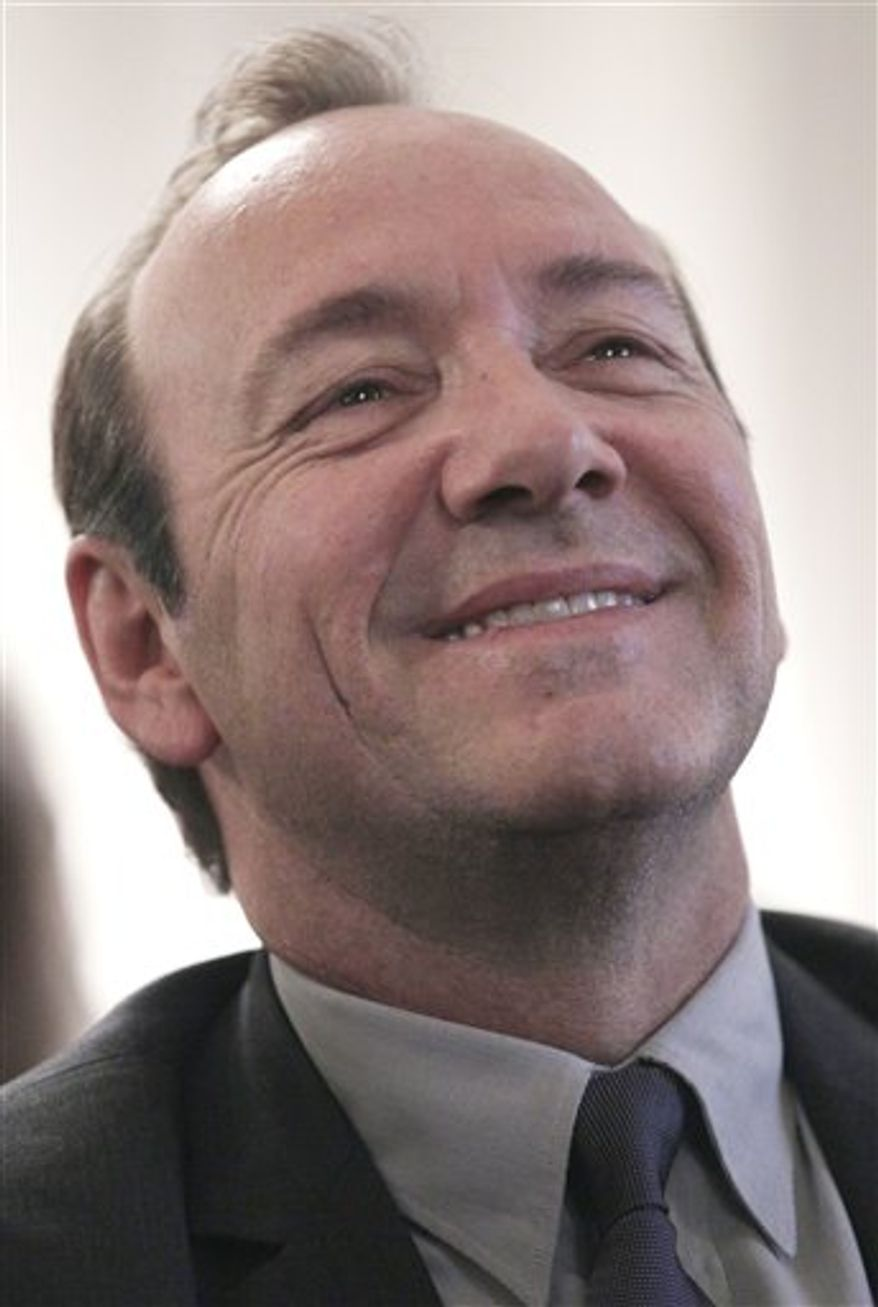 Actor Kevin Spacey attends an event on Capitol Hill in Washington, Tuesday, April 5, 2011, held by Americans for the Arts in conjunction with the Congressional Arts Caucus , calling for Congress to preserve arts funding.  (AP Photo/Carolyn Kaster)
