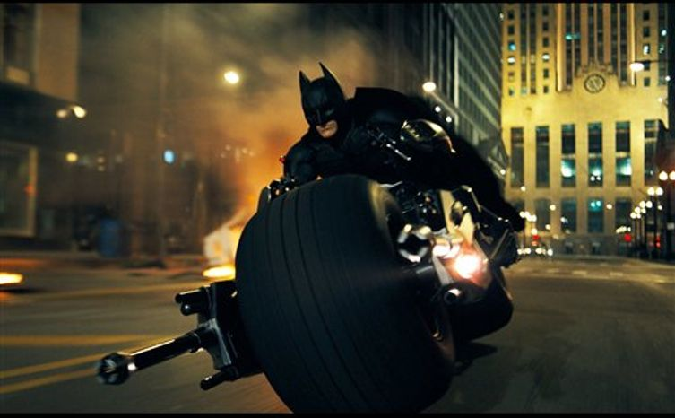 """FILE - In this undated file image released by Warner Bros., Christian Bale is shown as Batman in a scene from """"The Dark Knight.""""  Film director Christopher Nolan, who has helmed the two previous Batman films said Tuesday, April 5, 2011, that  the next Batman film, """"The Dark Knight Rises,"""" will be filmed in Pittsburgh, Pa., in July. (AP Photo/Warner Bros.)"""