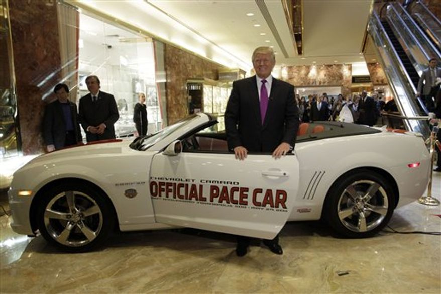 Donald Trump is photographed during a news conference at the Trump Tower, Tuesday, April 5, 2011 in New York. Indianapolis Motors Speedway announced Tuesday that Trump will be the 100th Anniversary Indianapolis 500 pace car driver. (AP Photo/Mary Altaffer)
