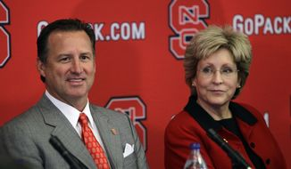 North Carolina State University athletics director Deborah A. Yow, right, sits with former Alabama coach Mark Gottfried during the announcement to name Gottfried as the school's new head basketball coach during a news conference in Raleigh, N.C., Tuesday, April 5, 2011. Gottfried replaces former coach Sidney Lowe who recently resigned. (AP Photo/Gerry Broome)