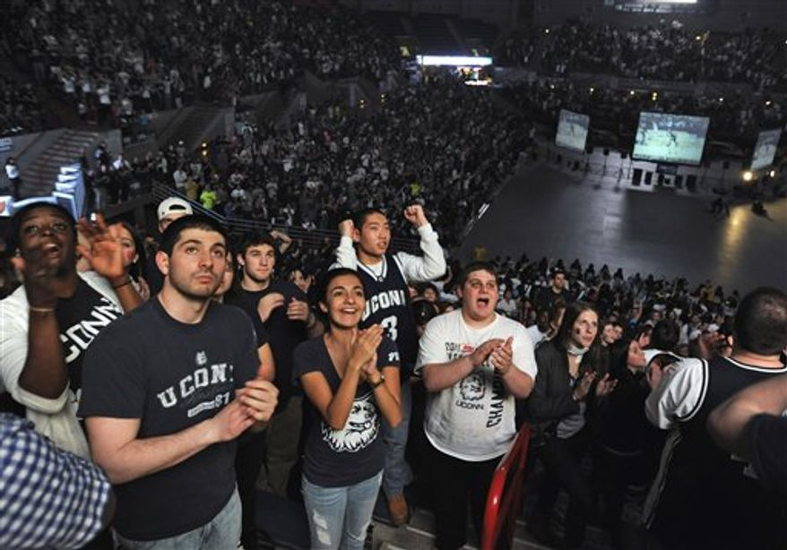 Connecticut students celebrate in Storrs, Conn., after UConn beat Butler 53-41 in Houston in the championship game of the NCAA college basketball tournament Final Four, Monday, April 4, 2011. (AP Photo/Jessica Hill)