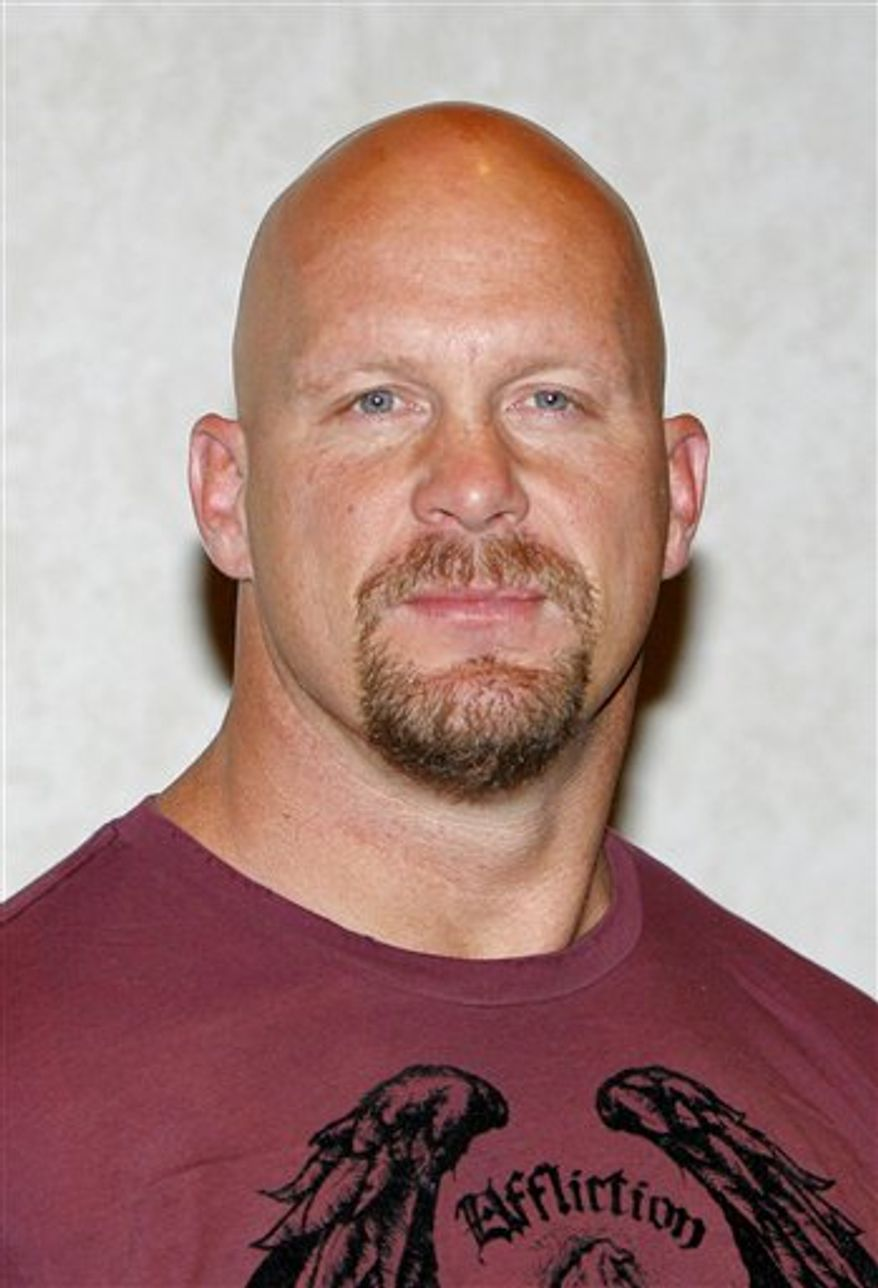 """FILE - In this March 14, 2007 file photo, actor and former wrestling champion Steve Austin poses as he arrives for a Lionsgate luncheon at the ShoWest convention in Las Vegas. Austin says """"Dancing with the Stars"""" isn't is cup of tea _ and he turned down an offer to be on the hit ABC series. In an interview Monday, April 4, 2011, the wrestler said he wasn't interested because he has """"two left feet"""" and his rhythm is """"so-so at best."""" (AP Photo/Jae C. Hong, File)"""