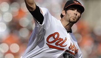 Baltimore Orioles starter Jake Arrieta delivers a pitch during the third inning of a baseball game against the Detroit Tigers, Monday, April 4, 2011, in Baltimore. (AP Photo/Nick Wass)