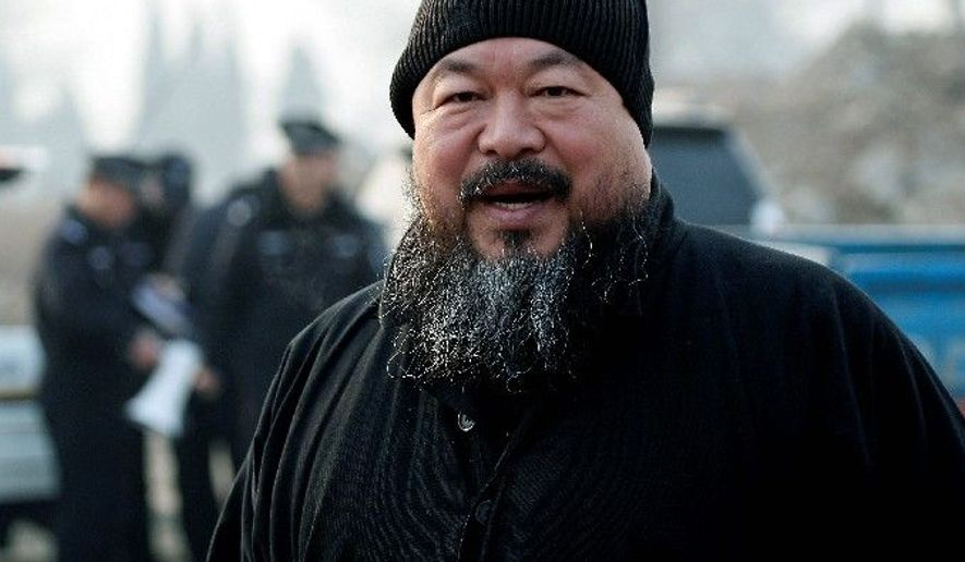 Artist and government critic Ai Weiwei was barred from boarding a plane and taken into custody on Sunday. (Associated Press)