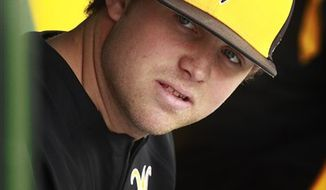 In this March 18, 2011, photo, Wichita State pitcher Albert Minnis looks down the bench at teammates before an NCAA college baseball game in Wichita, Kan. Minnis didn't expect to be labeled an NCAA rulebreaker when he shared the name of his legal adviser with the Atlanta Braves and other Major League Baseball clubs. In fact, his family enlisted the adviser to stay above board. Minnis has served a 30-game suspension since February, missing half of his first college season.(AP Photo/Orlin Wagner)