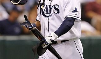 Tampa Bay Rays' Manny Ramirez reacts after striking out in the fourth inning of a baseball game against the Los Angeles Angels Tuesday, April 5, 2011, in St. Petersburg, Fla. (AP Photo/Mike Carlson)