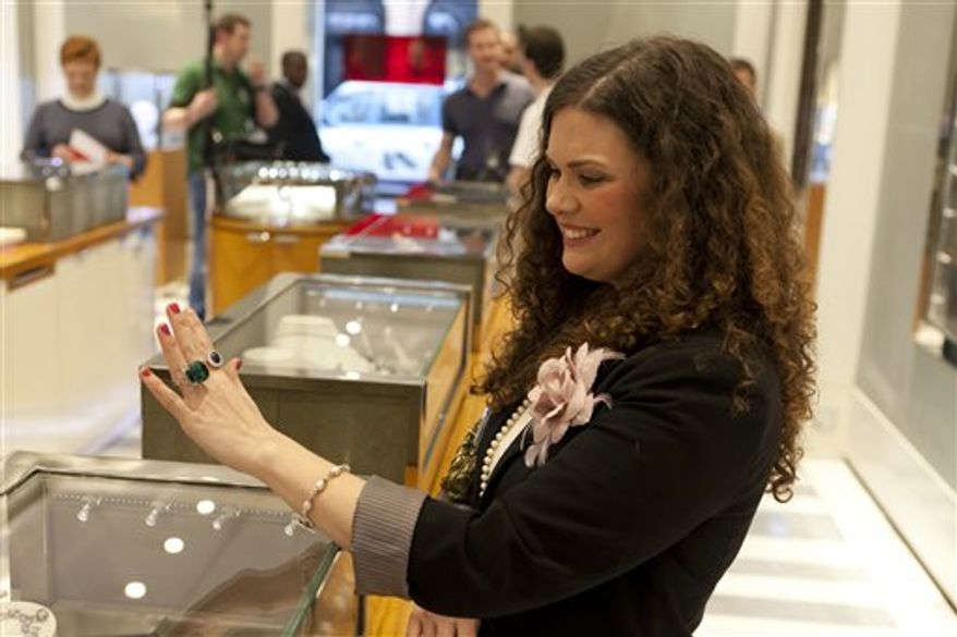 "This photo made available by the BBC photo made available Wednesday April 6 2011 shows Holly Passalaqua from The Royally Mad TV show during a visit to Garrard, the Royal  jewelers, in London. ""Royally Mad"" is one of a slate of BBC programs aimed at tapping the vast American appetite for royal wedding coverage. The network also plans to show the BBC's domestic coverage of the ceremony commercial-free on its American channel. (AP Photo/HO BBC) EDITORIAL USE ONLY IN CONNECTION WITH THE BBC SHOW ROYALLY MAD."