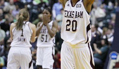 Texas A&M's Tyra White (20) celebrates after Texas A&M's 76-70 win over Notre Dame in the women's NCAA Final Four college basketball championship game in Indianapolis, Tuesday, April 5, 2011. (AP Photo/Michael Conroy)