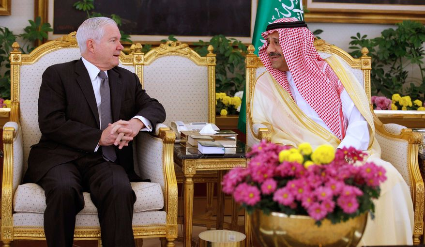 U.S. Defense Secretary Robert M. Gates (left) talks with the Saudi Arabian assistant minister of defense and aviation, Prince Khalid bin Sultan, during a ceremony after Mr. Gates' arrival in Riyad, Saudi Arabia, on Wednesday, April 6, 2011. Mr. Gates arrived in the Saudi capital Wednesday for talks with King Abdullah on coping with the political upheaval sweeping the Arab world. (AP Photo/Chip Somodevilla, Pool)