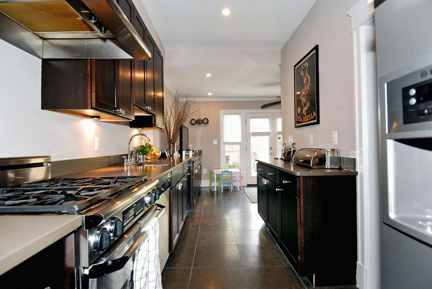 The renovated kitchen has limestone counters and upgraded stainless steel appliances.