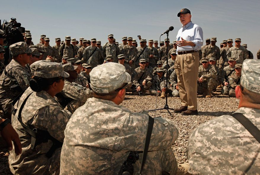 Defense Secretary Robert M. Gates talks with troops from the Army's 25th Infantry Division from Hawaii and answers their questions during a visit at Camp Victory on Thursday in Baghdad. Mr. Gates is meeting with military and civilian leaders during what he described as possibly his last trip to Iraq as defense secretary. (Associated Press)