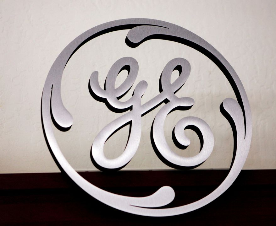 """General Electric will build a plant to make solar panels. """"We think we can push costs lower, and faster,"""" said Vic Abate, a GE vice president. (Associated Press)"""