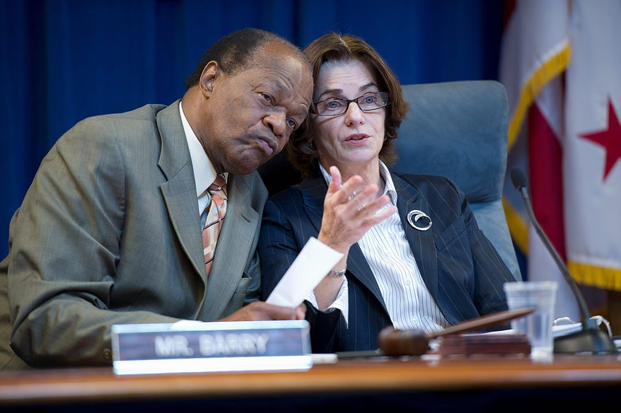 D.C. Council member Mary M. Cheh confers Thursday with council member Marion Barry. She plans to hold more hearings on the personnel practices of Mayor Vincent C. Gray's administration. She is chairwoman of the Government Operations Committee. (Barbara L. Salisbury/The Washington Times)