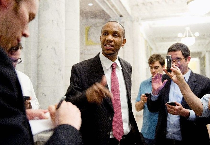 OPTS OUT: Former mayoral candidate Sulaimon Brown speaks to reporters in the John A. Wilson Building lobby Thursday during a hearing on the personnel practices of Mayor Vincent C. Gray's administration. He chose not to testify. (Barbara L. Salisbury/The Washington Times)