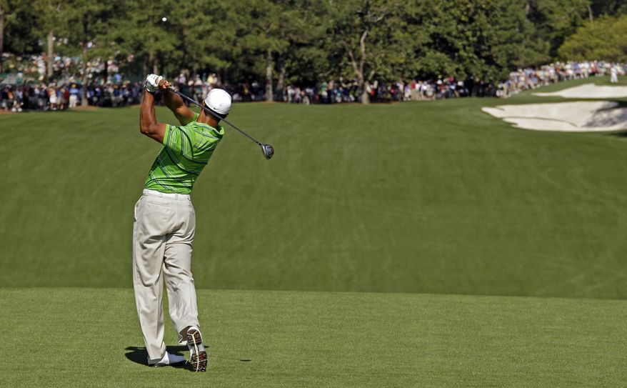 Tiger Woods tees off at the first hole during the first round of the Masters golf tournament Thursday, April 7, 2011, in Augusta, Ga. (AP Photo/Charlie Riedel)