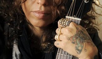 In this March 8, 2011 file photo, songwriter Linda Perry poses for a portrait in Los Angeles. (AP Photo/Chris Pizzello)