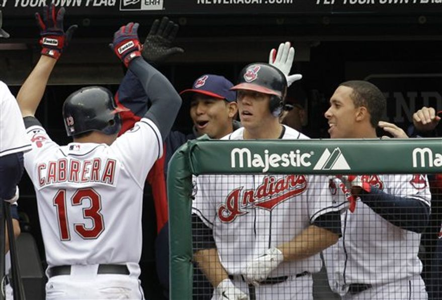 Cleveland Indians starting pitcher Fausto Carmona pitches in the first inning in a baseball game against the Boston Red Sox, Thursday, April 7, 2011, in Cleveland. (AP Photo/Tony Dejak)